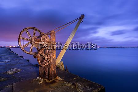 old rusty manual dock crane on