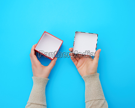 girl opens a brown square box