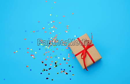 brown gift box wrapped in paper