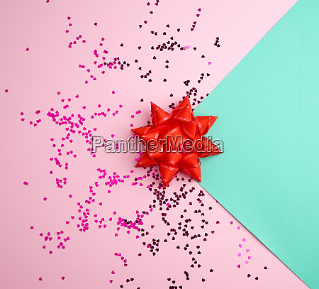 red bow and shiny multicolored round