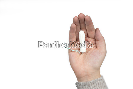 white clean tampon on womans hand