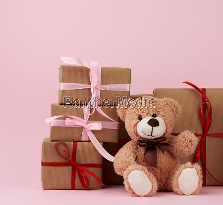 teddy bear and gifts wrapped in