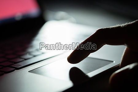 hand of a person using touchpad