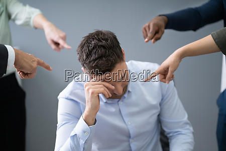 many hands pointing the stress businessman
