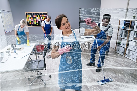 happy female worker cleaning glass