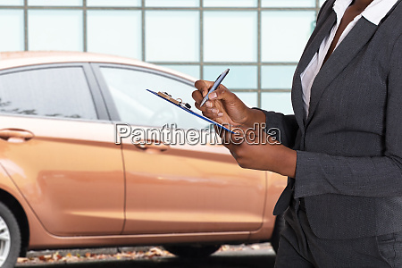 woman holding insurance paper and pen