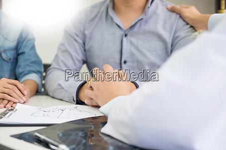 patient being reassured desperate holding hand