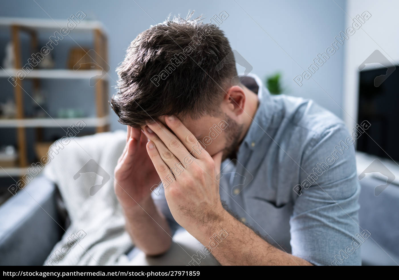 man, suffering, from, headache, at, home - 27971859