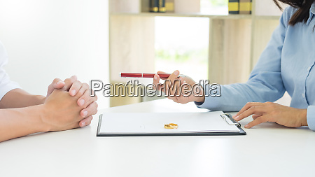 closeup of a man signing contract