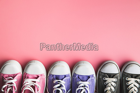 retro sneakers tennis shoes on pink