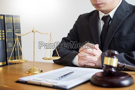 tribunal attorney lawyer working with documents