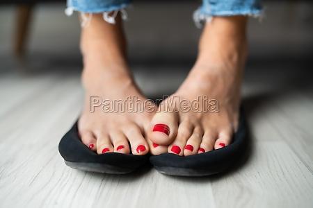 woman sweaty feet on shoes