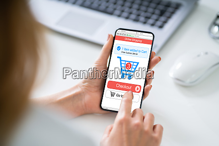 mobile with online shopping application on