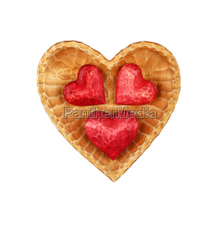three red wooden hearts in bowl