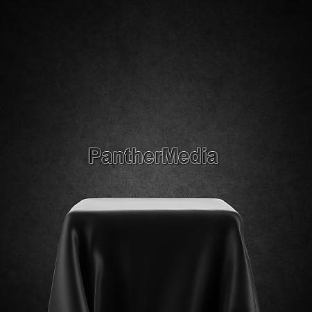 black and white spotlight pedestal table