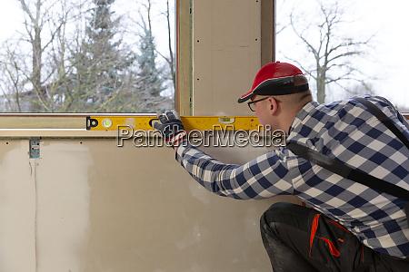 home improvement handyman installing window sill