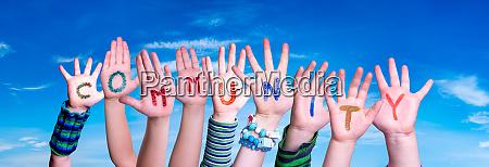 children hands building word community blue
