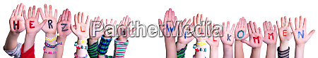 children hands building word willkommen mean