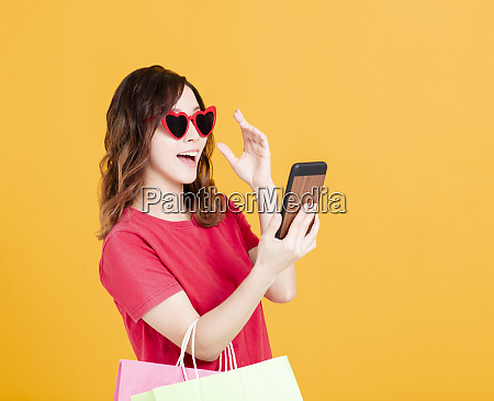 happy young women watching smartphone