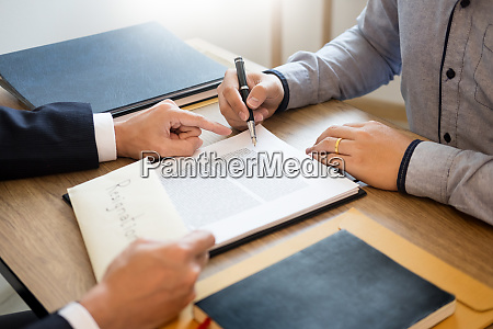 businessman hand sending a resignation letter