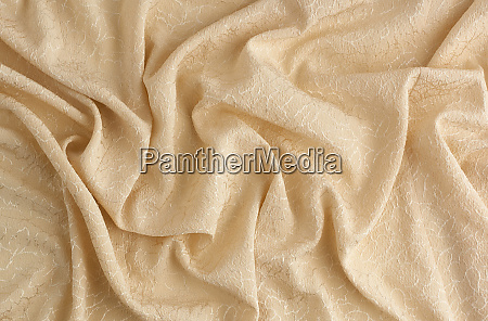 beige satin textile fabric with embroidery