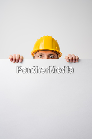 worker holding blank board on white