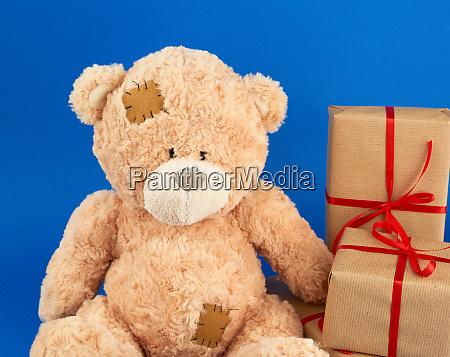 cute big beige teddy bear holds