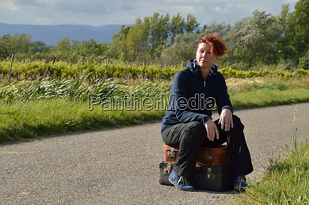selfconfident red haired woman on vacation
