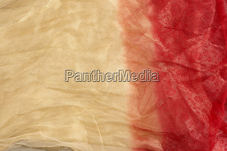 crumpled yellow red tulle fabric for