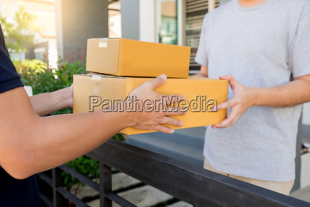 delivery service concept customer hand receiving