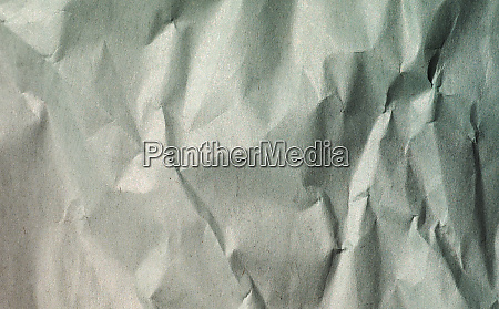 green crinkled paper texture background