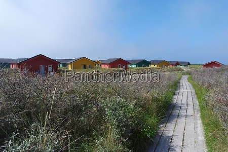 wooden houses on the beach at