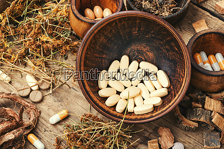 medical pills with healing herbs