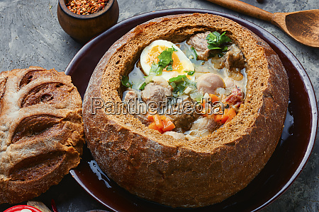polish soup zurek in bread pot