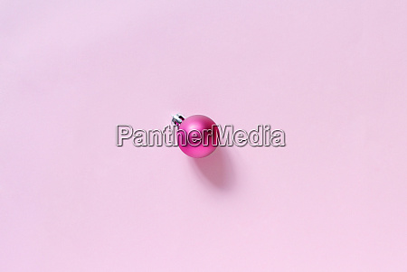 pink christmas bauble on a light