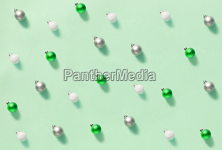 christmas baubles on a light green