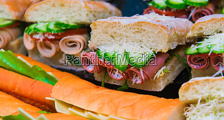 sandwiches with vegetables and ham sold