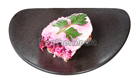 portion of dressed herring russian salad