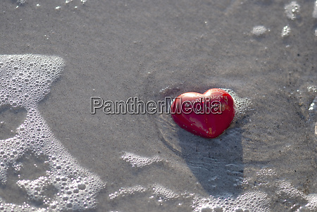 red heart on the beach