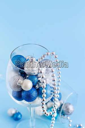 christmas baubles in a wine glass
