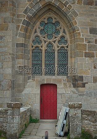 entrance at stone gothic style catholic