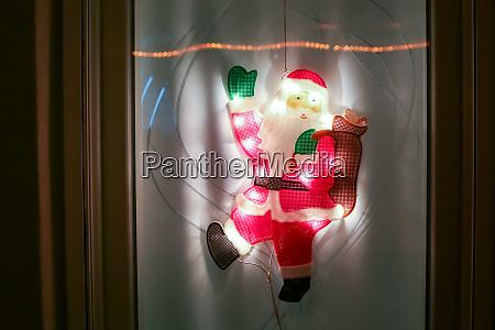santa claus home decoration at night