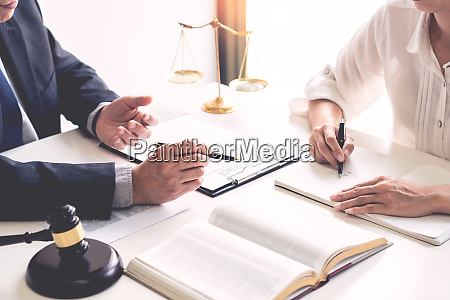 business people and lawyers discussing contract
