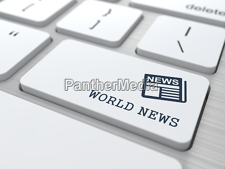 world news concept on white keyboard