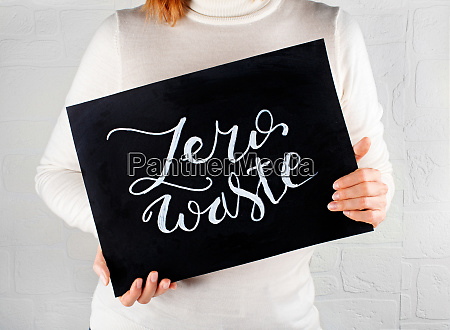 woman keeping a small chalkboard with