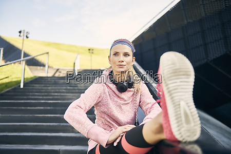 female runner warming up before workout