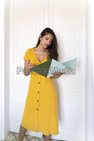 young woman looking in folder