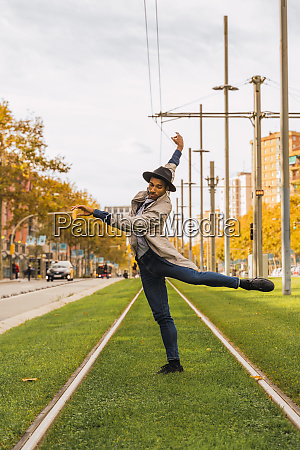 young man moving and dancing on