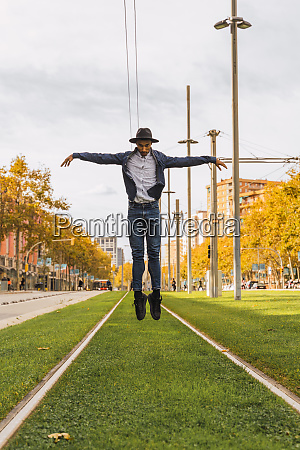 young man jumping and dancing on