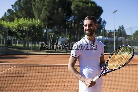 attractive bearded man in tennis wear